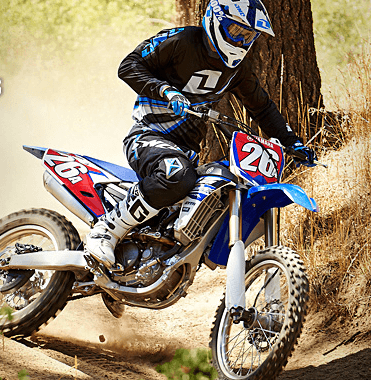 Guy riding dirt bike